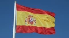 Spanish Flag waving against a blue sky Stock Footage