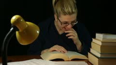 Happy woman reading book at night Stock Footage