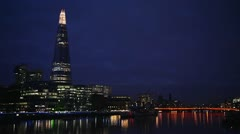 The Shard and Southwark night skyline in London, UK Stock Footage