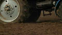 Rural farmland and tractor ploughing Stock Footage