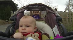 Big Sister pushes stroller Geat View of the Baby Stock Footage