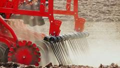 Tractor and Seeder Planting Crops on a Field. Tractor pulling seed drill. Tracto Stock Footage