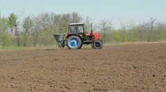 Farm tractor spraying field Stock Footage