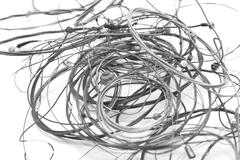 Old metal strings on a white background Stock Photos