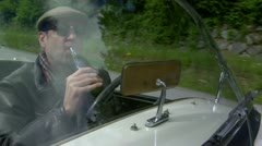A man drunk and driving the Vintage Classic Car in Europe Stock Footage