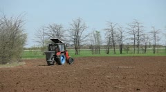 Tractor spraying field before planting Stock Footage