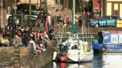 Group of People Relaxing in the Sun, on Bristol Waterfront, UK HD Stock Footage
