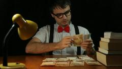 Funny nerd man counting money at night Stock Footage