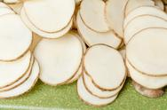 Sliced potatoes on green cutting board Stock Photos