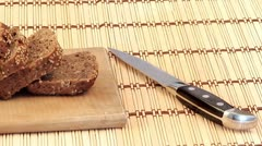 Rye-bread cutting Stock Footage