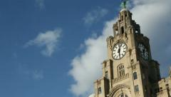 pan of liver buildings, liverpool, england on sunny day - stock footage