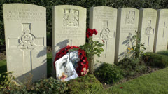Poet Wilfred Owens grave & the Ors Communal Cemetery, Ors, France Stock Footage