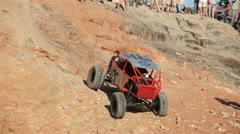 Red jeep rock crawling Stock Footage