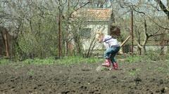 Little Gardener Digging on Smallholder Farm Stock Footage