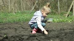 Little Girl Planting Peas on Smallholder Farm Stock Footage
