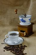 Coffee with antique coffee mill Stock Photos