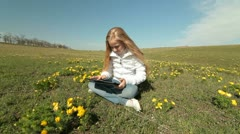 Child Using a Touch Screen Tablet PC Outdoors Stock Footage