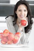 Woman holding an apple Stock Photos