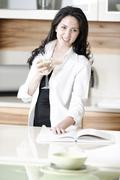 woman reading recipe book - stock photo