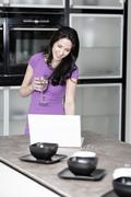 Woman in elegant kitchen Stock Photos