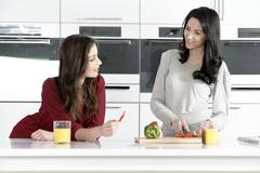 Stock Photo of two friends preparing food