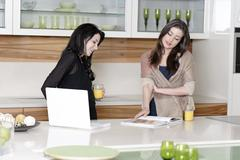 two friends reading recipes - stock photo