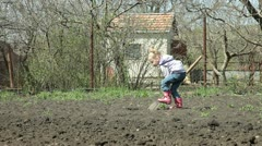 Little Gardener Digging on Smallholder Farm Stock Footage