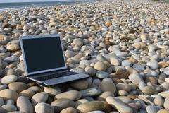 Personal computer isolated at the beach Stock Photos