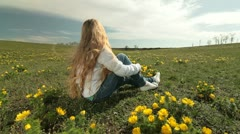 Child on a spring meadow of wild peonies Stock Footage