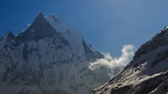 Clouds forming near the Machapuchare peak in the Himalayas Stock Footage