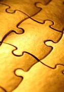 golden jigsaw - stock illustration