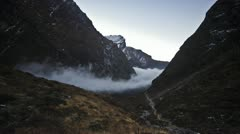 Cloud river forming/disappearing in the valley in the Himalayas Stock Footage