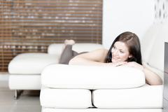 woman relaxing on her sofa - stock photo