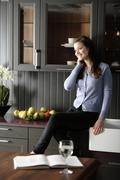 woman in her stylish kitchen - stock photo