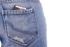 Cellphone in woman's pocket Stock Photos