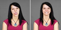 young woman pulling tongue and smiling - stock photo