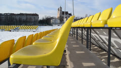 Volleyball court rows yellow chairs in the distance yellow bus Stock Footage