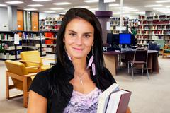 Young woman at library Stock Photos