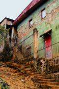 old houses in poor tropical neighborhood - stock photo