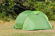 Stock Photo of outdoor green tourist tent at field