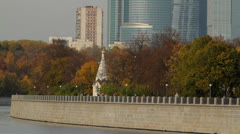 Moscow city in motion. View from the Moscow river through the park 1 Stock Footage