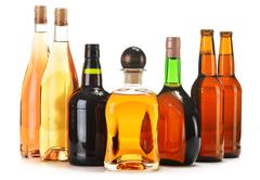 Assorted alcoholic beverages isolated on white Stock Photos