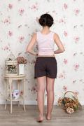 young teenager girl in pajamas - view from the back - stock photo