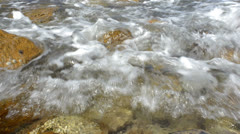 Wave washing onto rocks in the sea Stock Footage