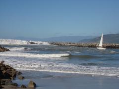 Big wave and sailboat Stock Photos