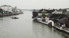 Zhujiajiao traditional wooden boat across the river - stock footage