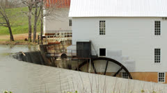Historic grist mill working water wheel dam Stock Footage