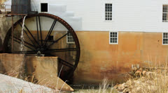Historic grist mill working water wheel Stock Footage