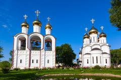 white steeple church with three domes - stock photo