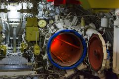 torpedo room and torpedoes - stock photo